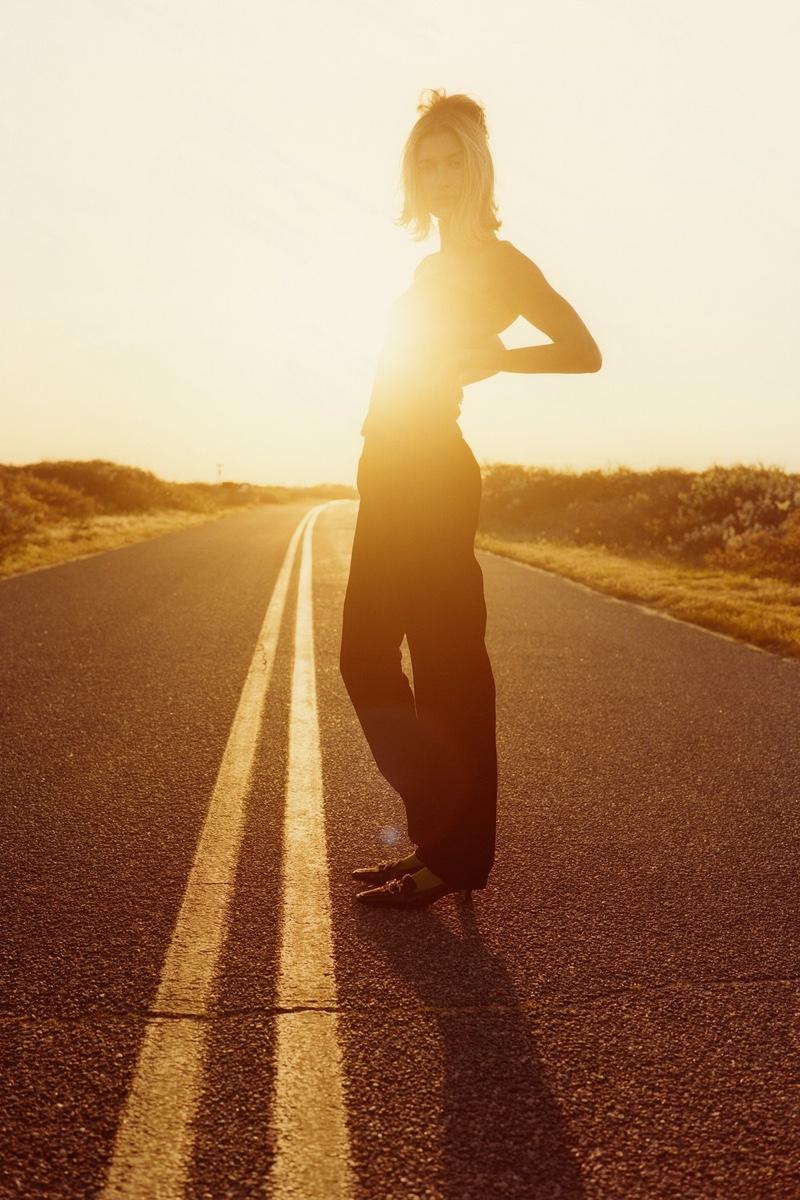 Giorgio Armani top and pants; Music Legs tights; Bottega Veneta shoes.Hailey Bieber by Colin Dodgson for W Magazine.