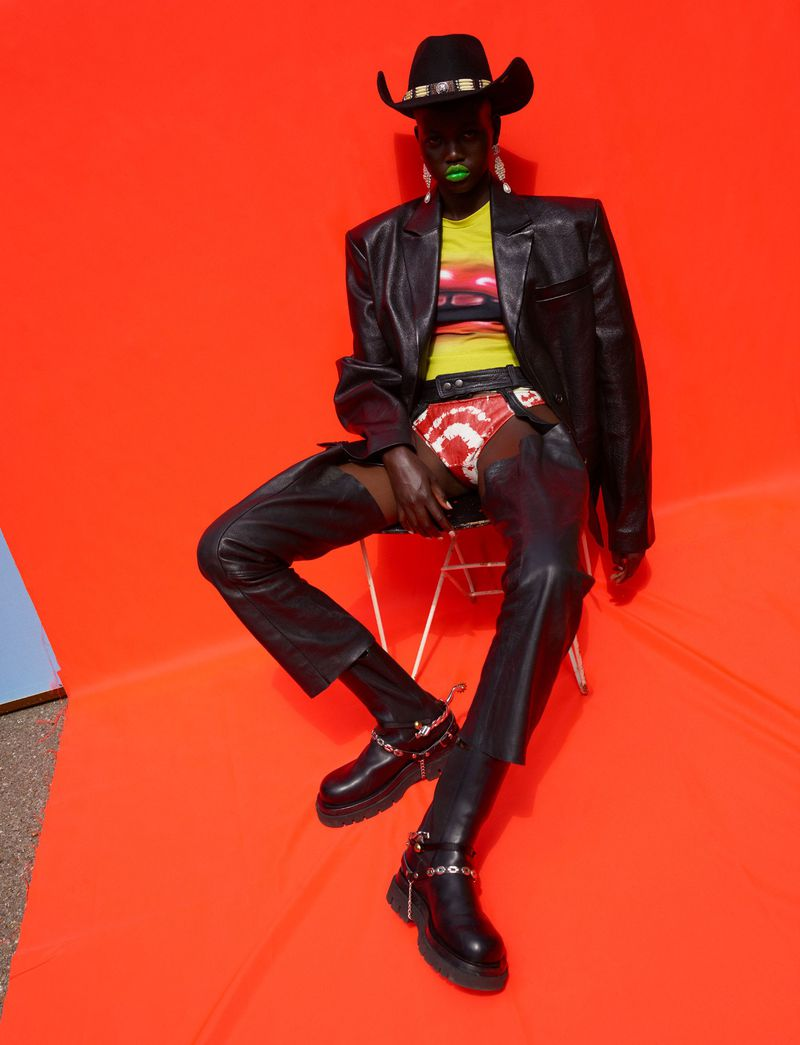 Leather blazer Nina Ricci, Bloody Mouth baby t-shirt Mowalola, leather chaps Angharad Merrey for Savannah, tie-dye leather briefs Area, felt hat and boot buckles Jessie Western, pearl earrings Chanel, boots Bottega Veneta. Adut Akech by Vivianne Sassen for Dazed Autumn 2019.