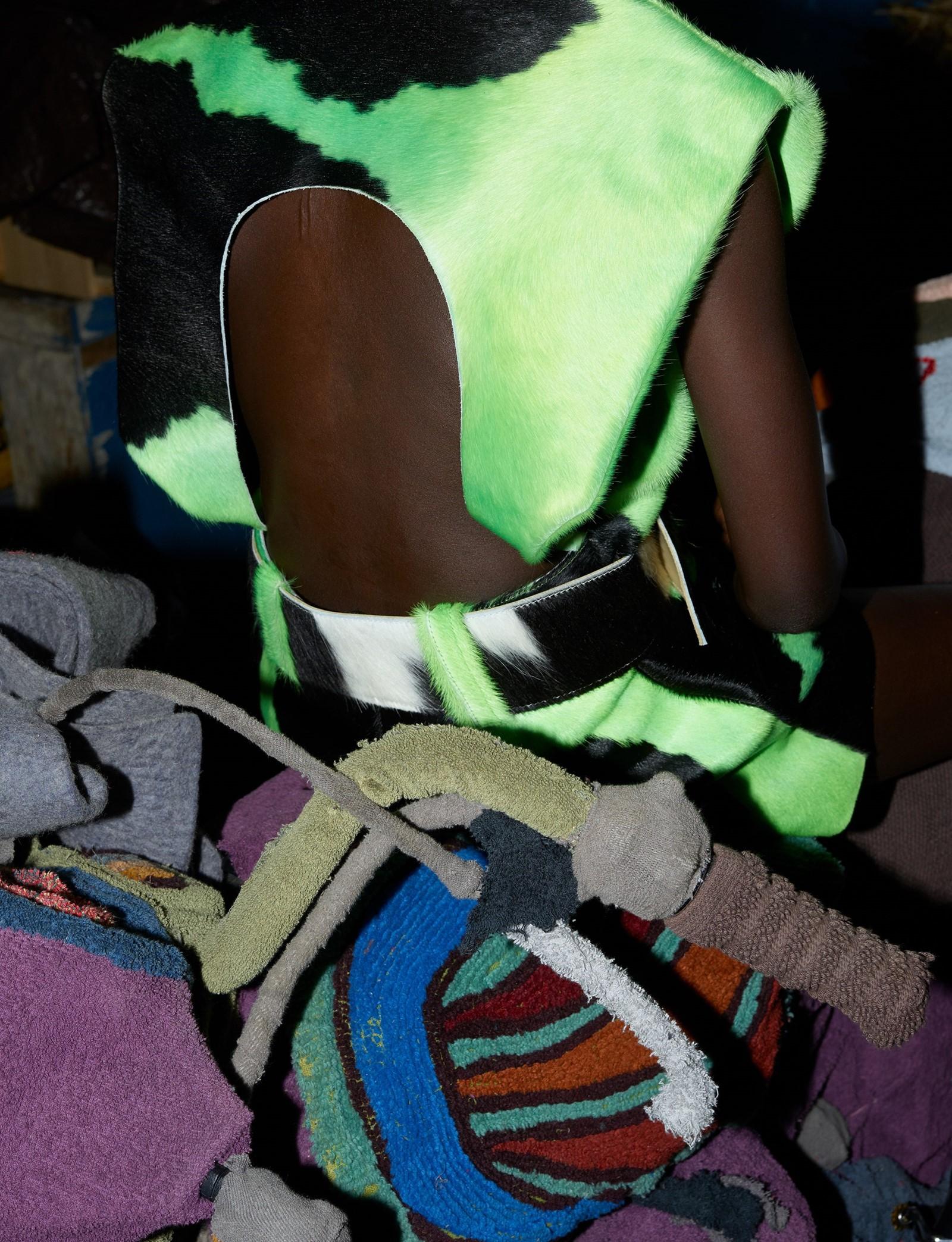 Acid cowhide dress with belt, Mowalola. Adut Akech by Vivianne Sassen for Dazed Autumn 2019.