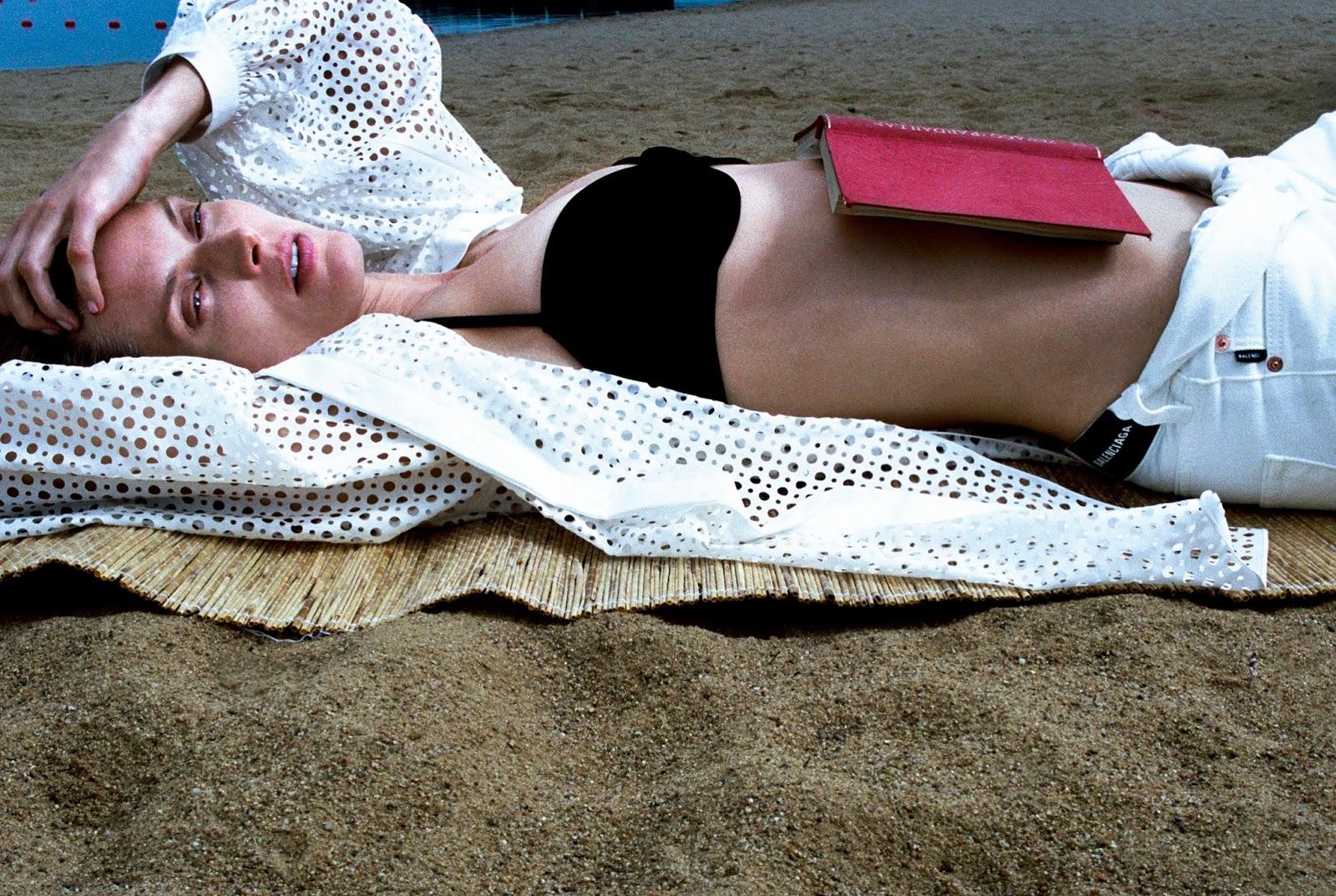 . Blouse The Row; bikini top Anemone; jeans Balenciaga. Malgosia Bela by Hugo Comte.