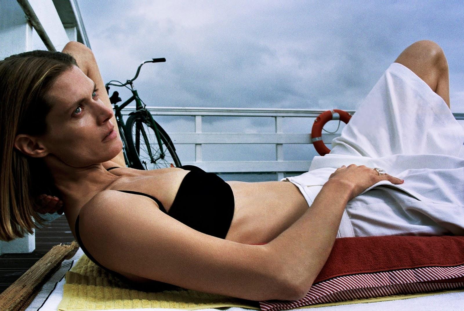 Bikini top Haight; shorts Vince; ring Malgosia's own. Malgosia Bela by Hugo Comte.