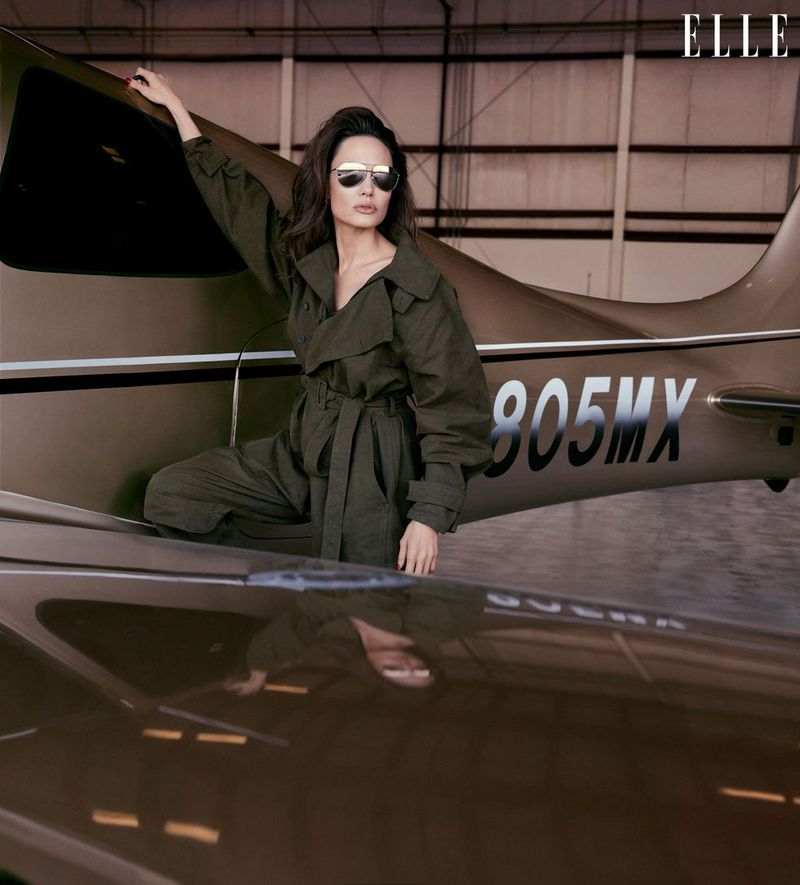 Jolie, an instrument-rated pilot stands beside her own plane. She bought it when her son Maddox was young (the tail number is his initials and birth date). Jumpsuit, Stella McCartney. Aviators, Dolce & Gabbana. Earrings, J. Hannah. Angelina Jolie by Alexi Lubomirski.