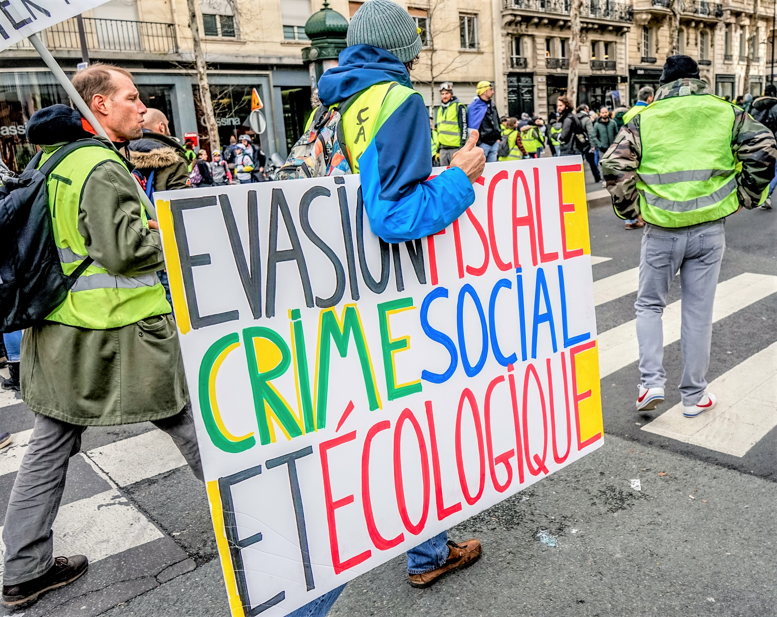 Thousands of yellow vests (Gilets Jaunes) protests in Paris calling for lower fuel taxes, reintroduction of the solidarity tax on wealth, a minimum wage increase, and Emmanuel Macron's resignation as President of France, 09 February 2019. By Norbu Gyachung, CC BY-SA 4.0.  via Wiki Commons.