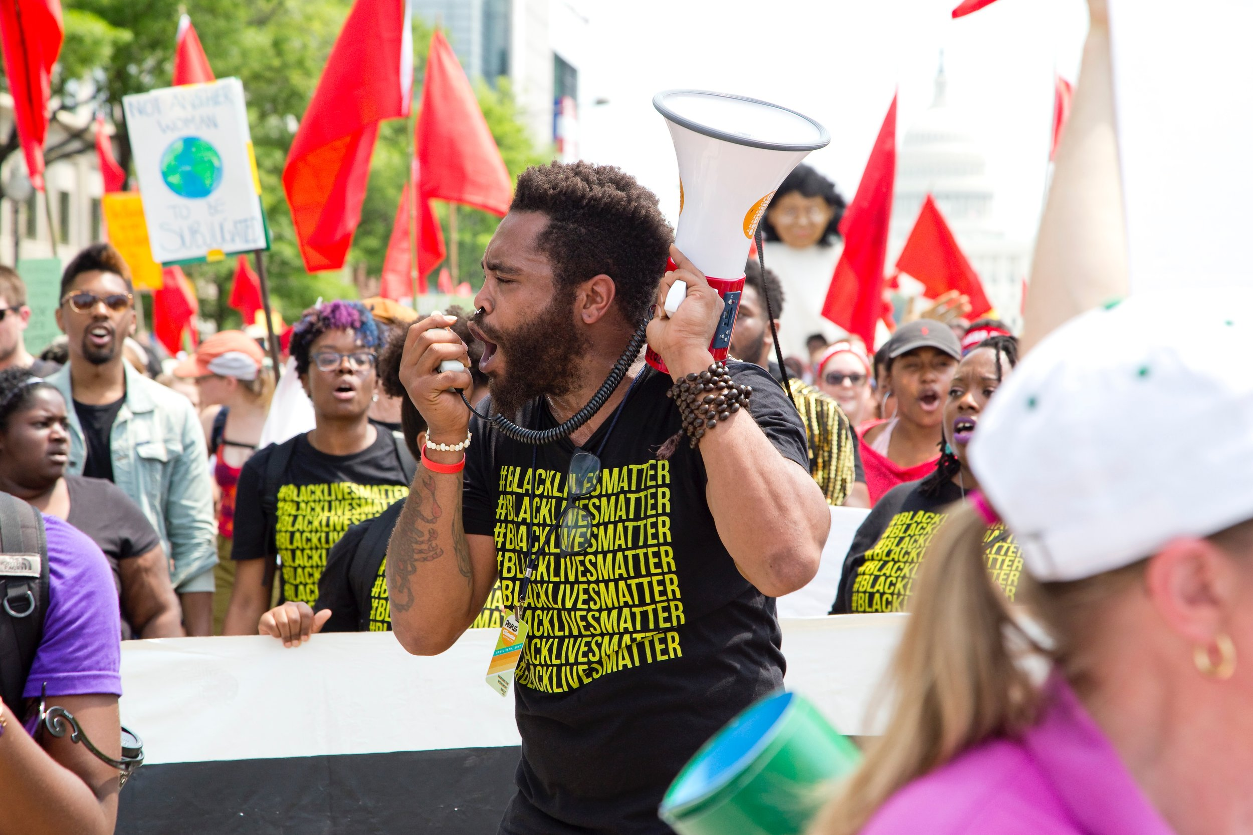 Photo by  Vlad Tchompalov  on  Unsplash . BLM fired up at the People's Climate March, Washington DC