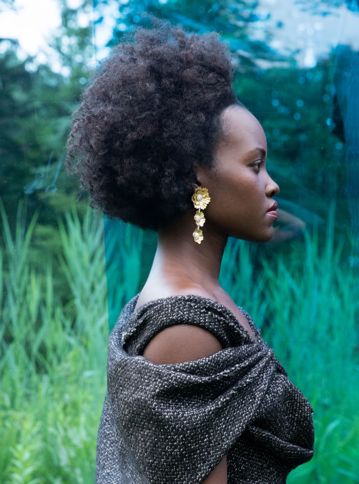 Dress by Prada; earrings by Irene Neuwirth.LUPITA NYONG'o. PHOTOGRAPH BY JACKIE NICKERSON; STYLED BY SAMIRA NASR.