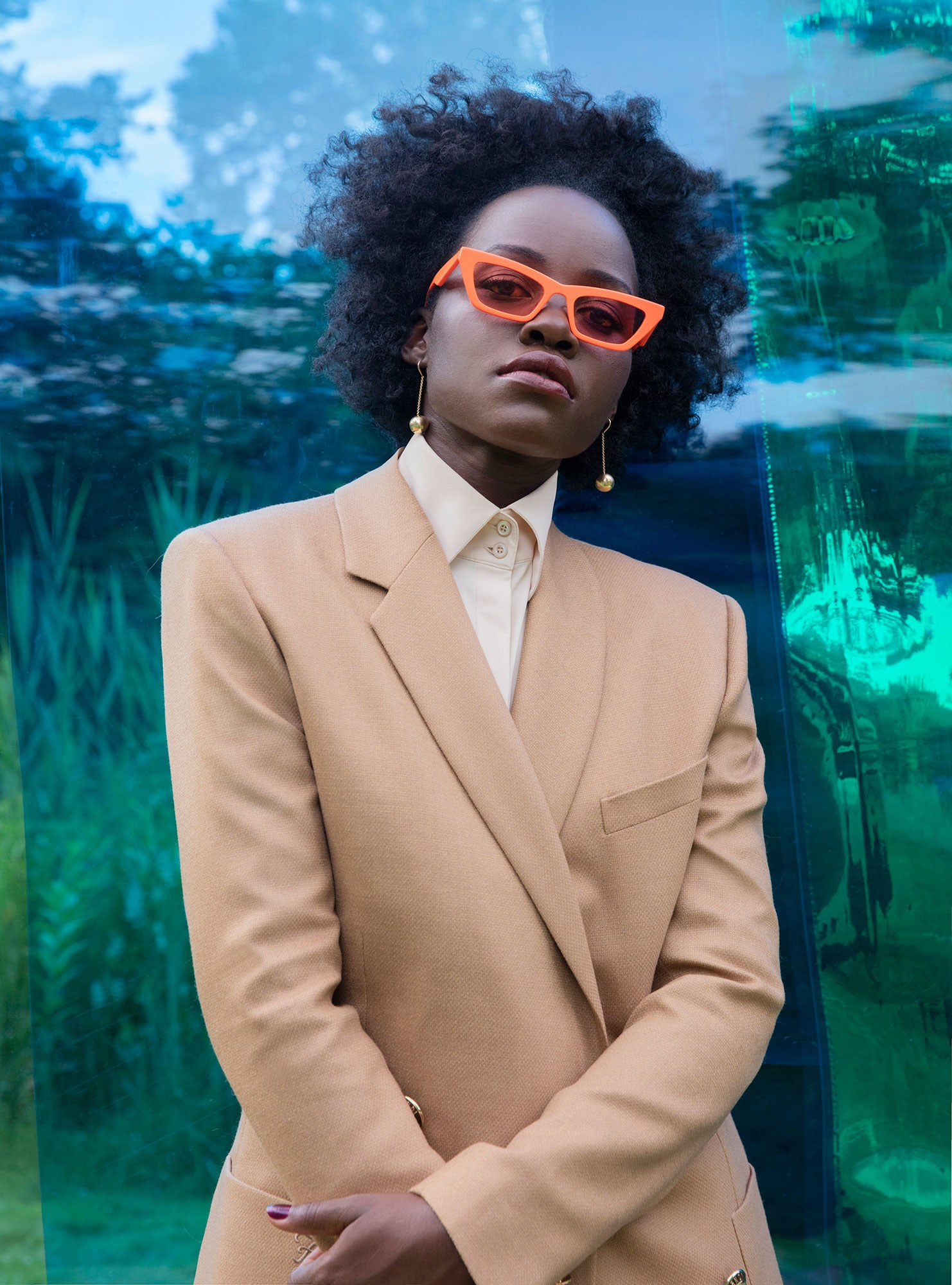 Clothing by Fendi; earrings by Tiffany & Co.; sunglasses by Gentle Monster. LUPITA NYONG'o. PHOTOGRAPH BY JACKIE NICKERSON; STYLED BY SAMIRA NASR.