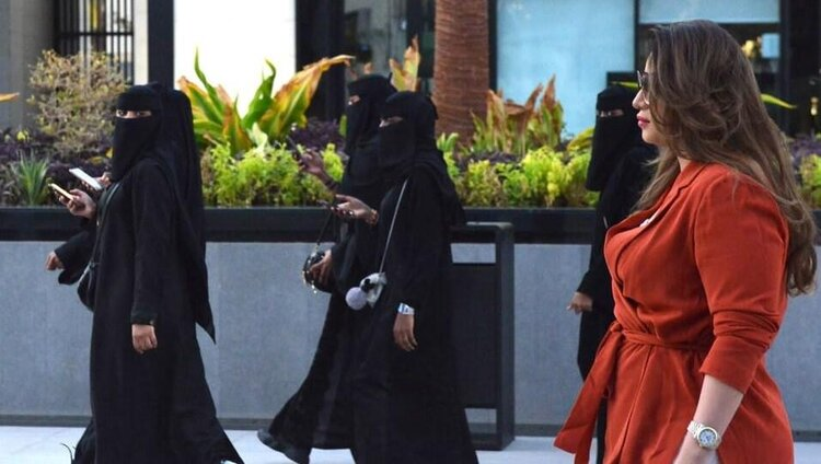 "Mashael Al-Jaloud  walked outside malls in Saudi Arabia yesterday, challenging the government's position on ""not forcing 'Abaya' upon Saudi women'.  via Middle East Monitor."