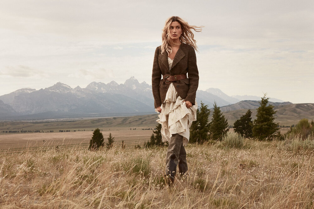Hailey Bieber by Daniel Jackson,  Vogue , October 2019.  via Vogue.com.  Bieber waltzes through the wildflowers at the fifth- generation family-owned Jackson Hole Hereford Ranch in a Brock Collection jacket and dress ($4,670). Jacket at  modaoperandi.com . Dress at  fortyfiveten.com . Isabel Marant belt. Tabitha Simmons x Johanna Ortiz boots.