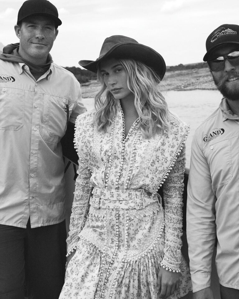 Hailey Bieber by Daniel Jackson,  Vogue , October 2019.  via Vogue.com.  With guides Josh Pope, left, and Joe Irby, right. Zimmermann dress, $3,500;  zimmermannwear.com . Stetson hat.