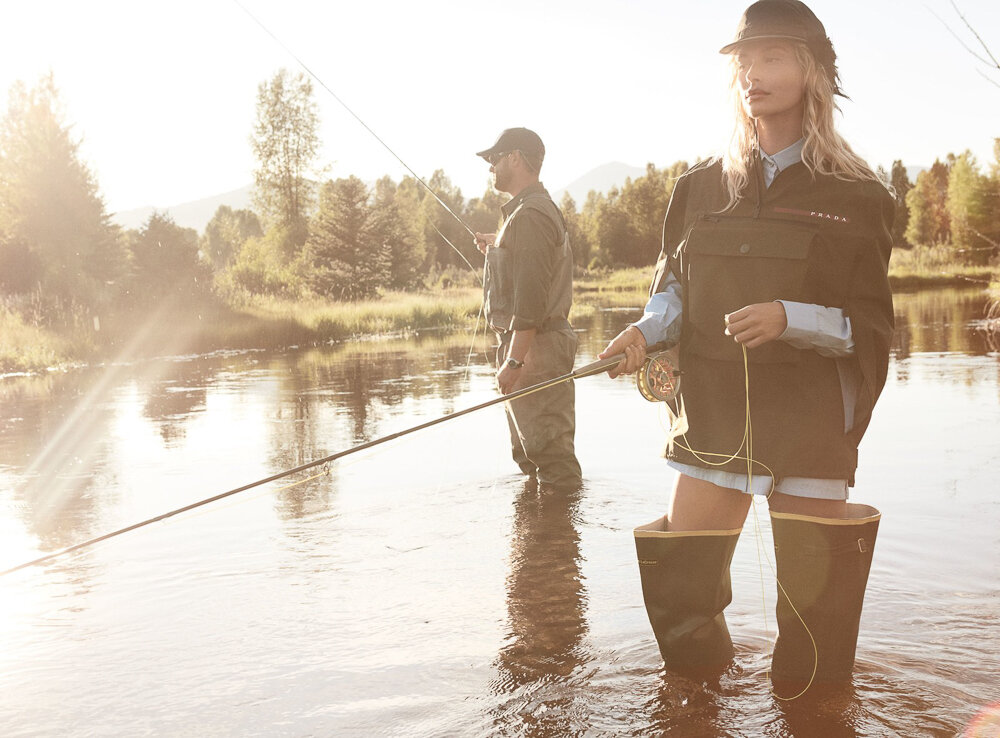 Hailey Bieber by Daniel Jackson,  Vogue , October 2019.  via Vogue.com.  Bieber (with WorldCast Anglers guide Mikey Hemkens) casts a line in a Prada jacket ($2,130), shirt ($690), and hat; select Prada stores. LaCrosse boots.