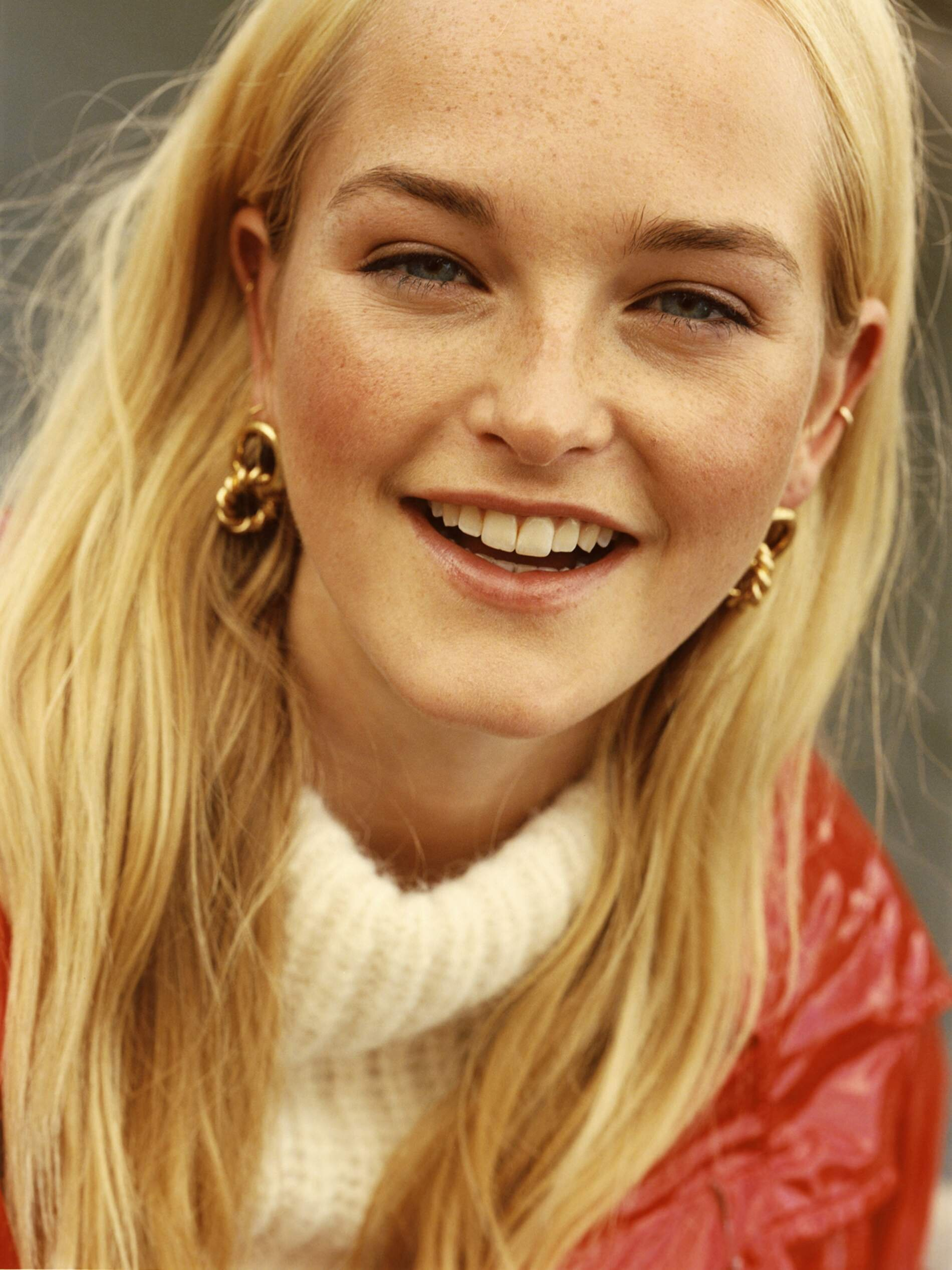 Image Jean Campbell by Quentin De Briey for Porter Edit. Coat, Balenciaga; sweater, Lauren Manoogian; earrings, Laura Lombardi; smaller earrings and ear cuff, model's own.