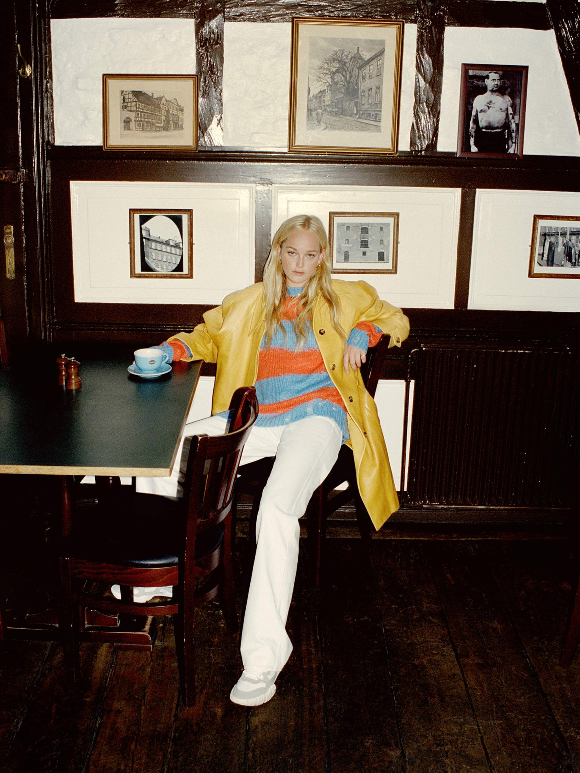 Image Jean Campbell by Quentin De Briey for Porter Edit. Coat, Miu Miu; sweater, Acne Studios; jeans, Goldsign; sneakers, Acne Studios; earrings, Sophie Buhai; ring, Grace Lee.