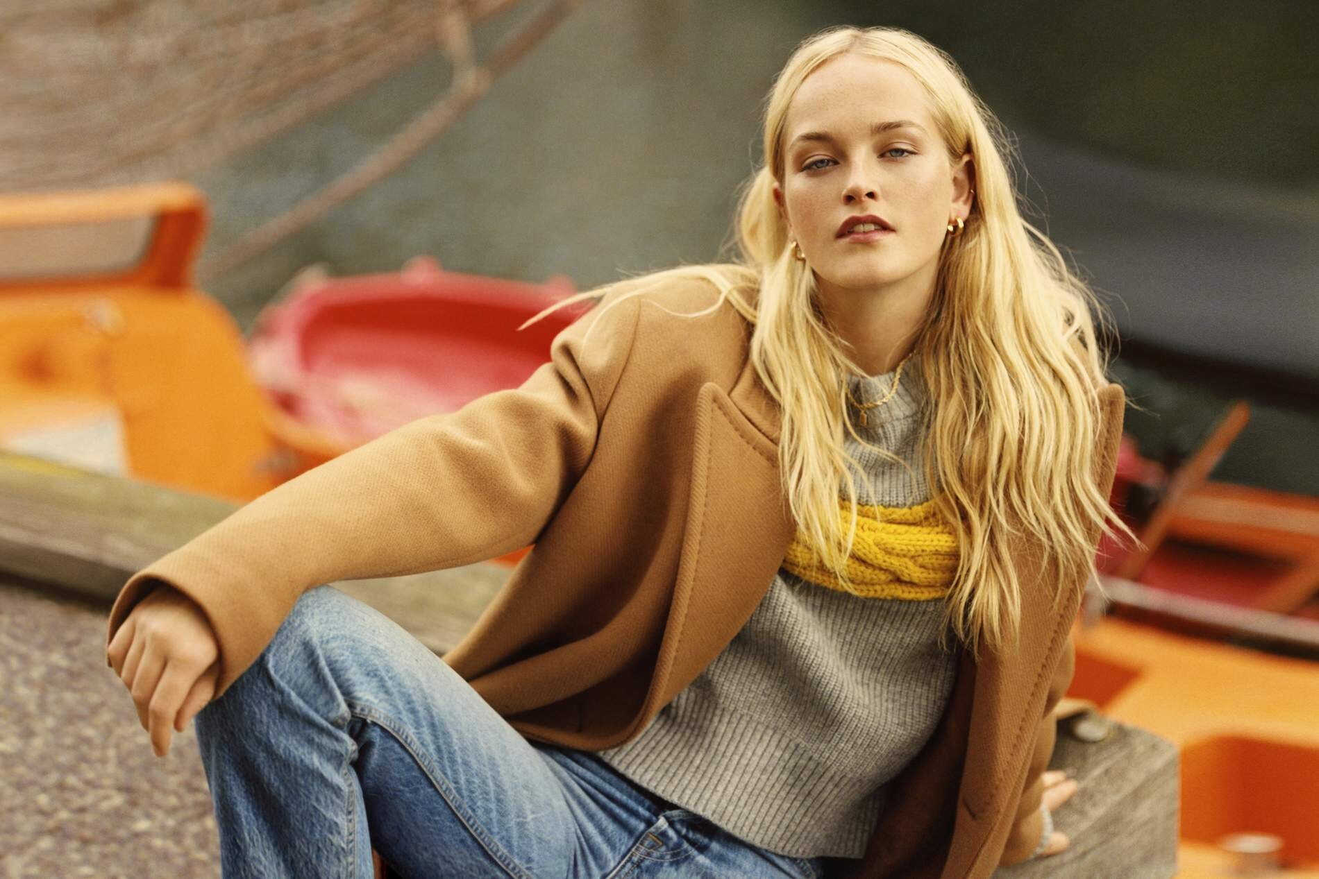 Image Jean Campbell by Quentin De Briey for Porter Edit. Coat, Stella McCartney; sweater, Sacai; jeans, Grlfrnd; earrings, Sophie Buhai; necklace, Stone And Strand