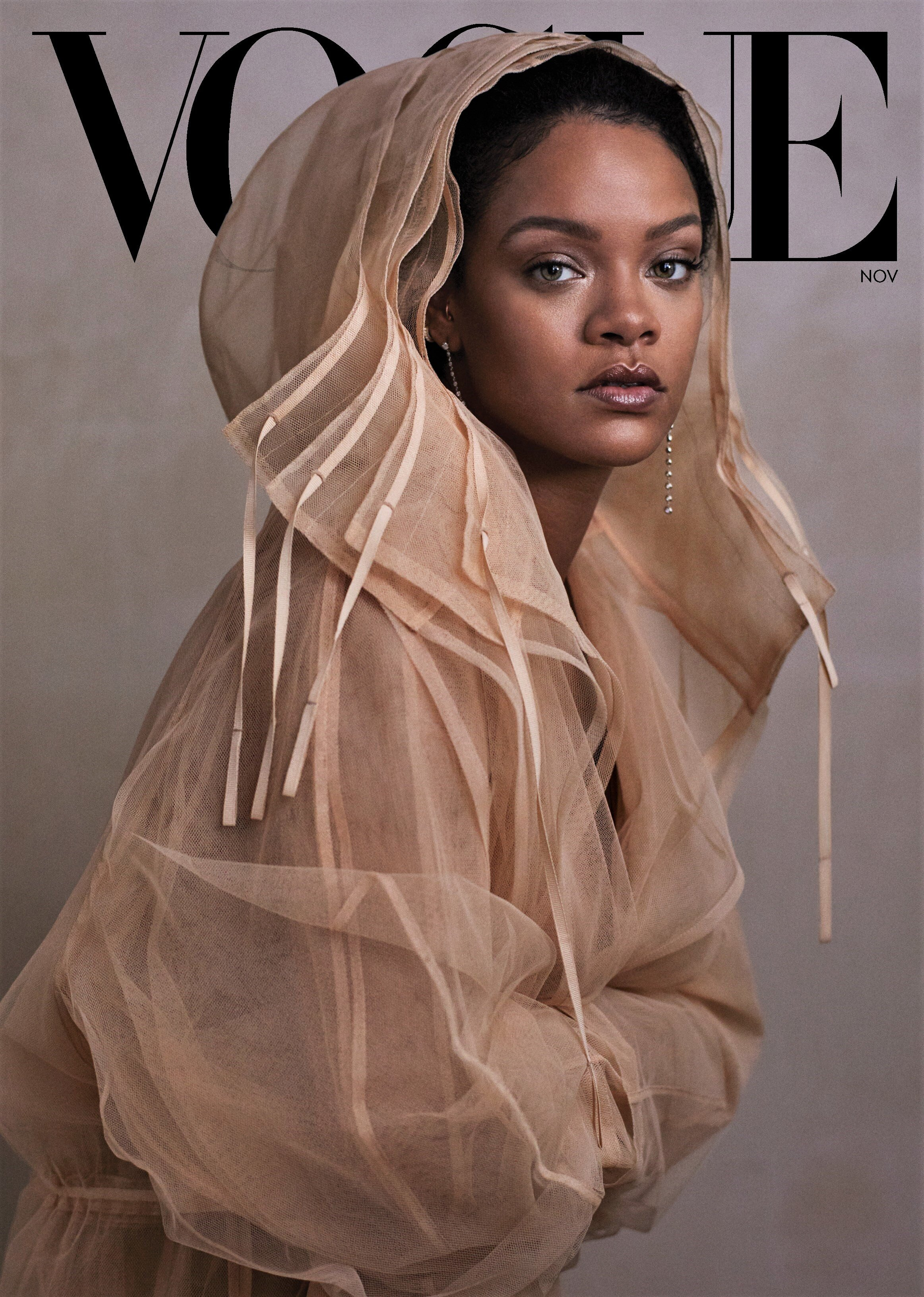 Cover Look  Rihanna wears a Fenty tulle coat. Forevermark and Maria Tash earrings. Hair, Yusef Williams; makeup, Kanako Takase.  Fashion Editor: Tonne Goodman. Photographed by Ethan James Green,  Vogue , November 2019