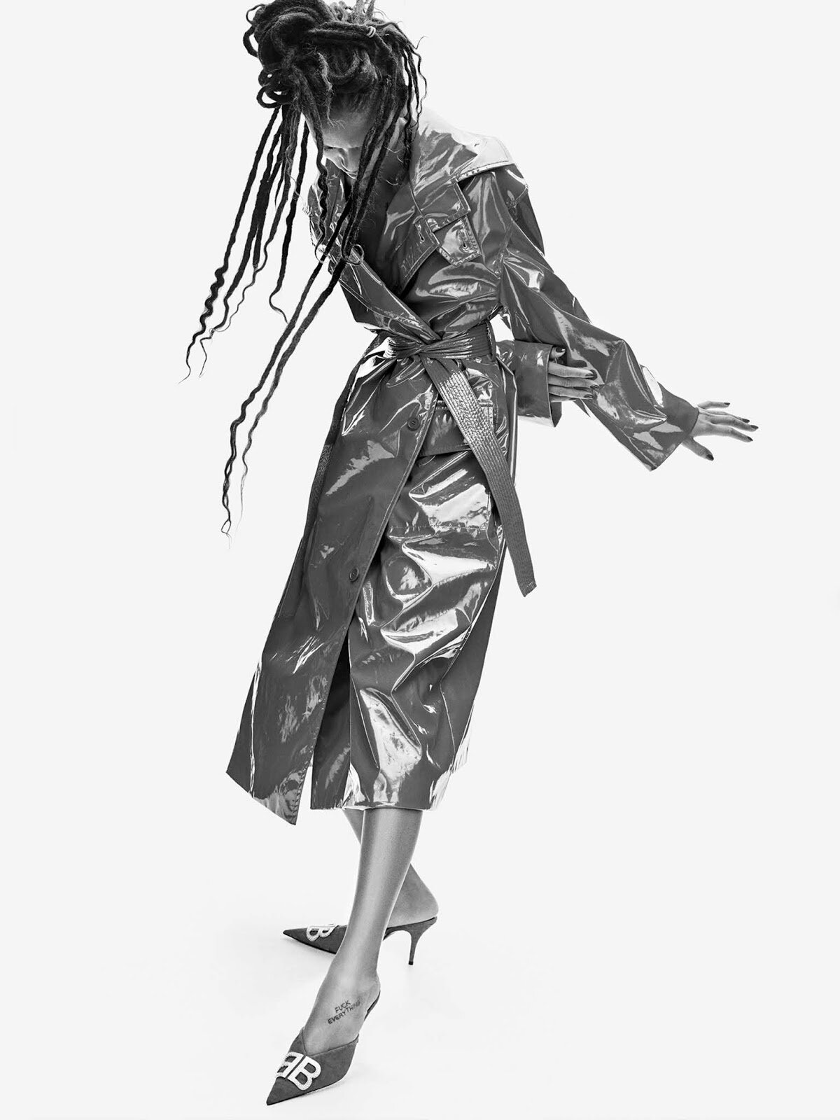 Beloved for avant-garde silhouettes and design innovation, Balenciaga puts its woman at the forefront of fashion. This PVC trench will set you apart for all the right reasons.  Coat, and shoes, both Balenciaga.  Adesuwa Aighewi by Phiip Messmann.