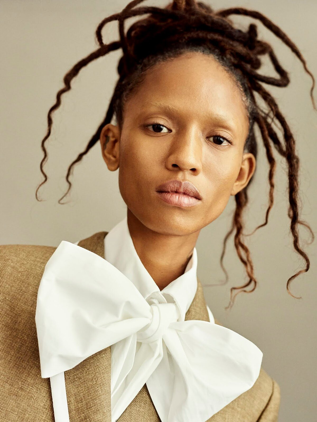 This precision-cut blazer and extravagant-bowed blouse opened the late Karl Lagerfeld's final collection for Fendi, making it a timeless heirloom from one of the fashion world's greatest designers.  Blazer, and blouse, both Fendi.  Adesuwa Aighewi by Philip Messmann.