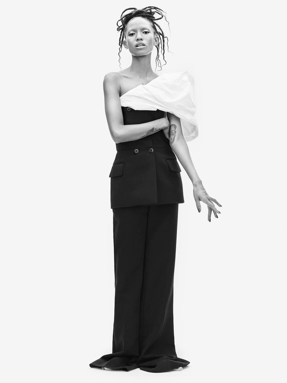 Clare Waight Keller knows her way around occasionwear. Majestic royal wedding gowns aside, her inventive eveningwear comes replete with magnificent puffs of crinkled taffeta for fall.  Bustier, top, and pants, all Givenchy.  Adesuwa Aighewi by Philip Messmann.