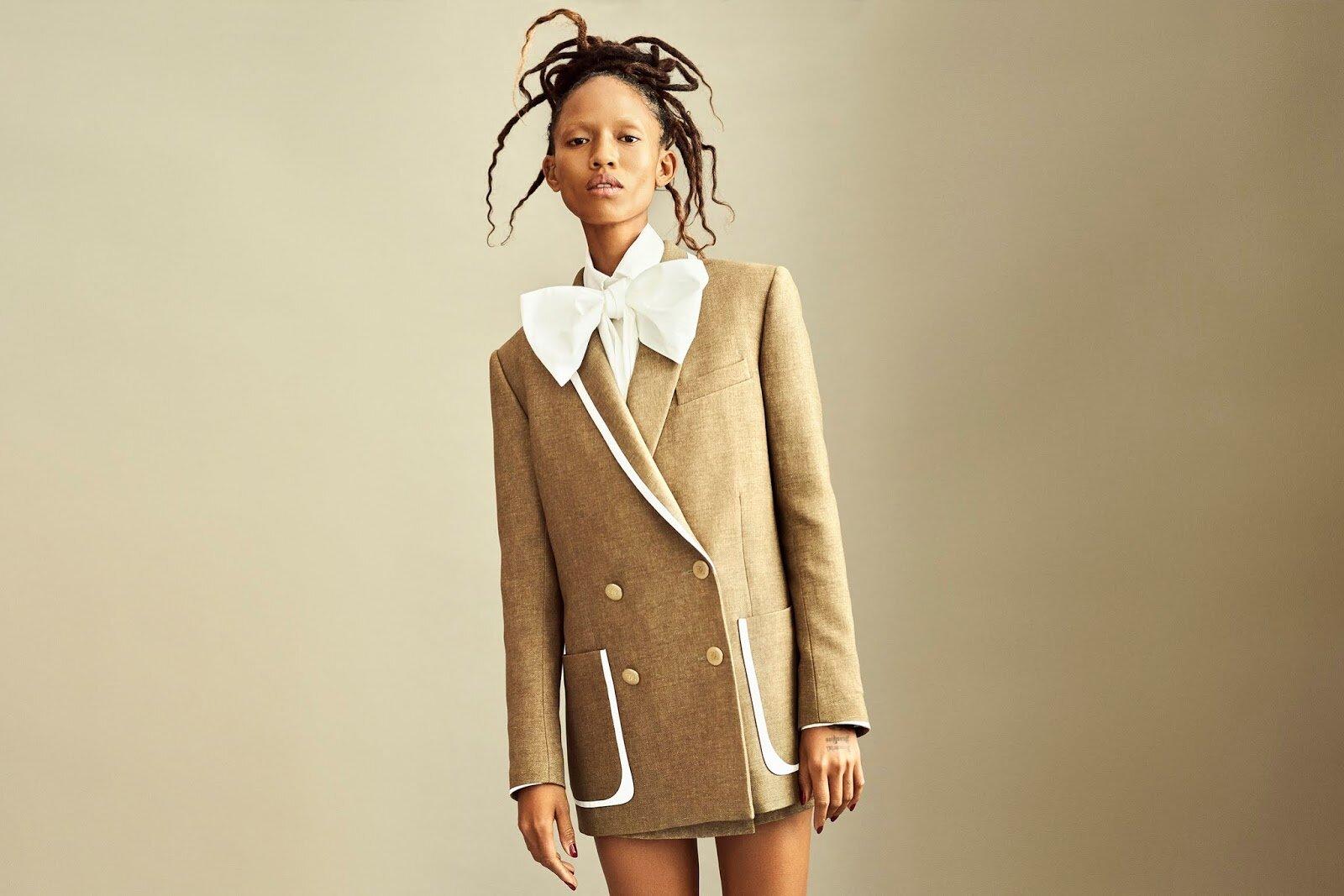 Blazer, skirt, and blouse, all Fendi. Adesuwa Aighewi by Philip Messmann.