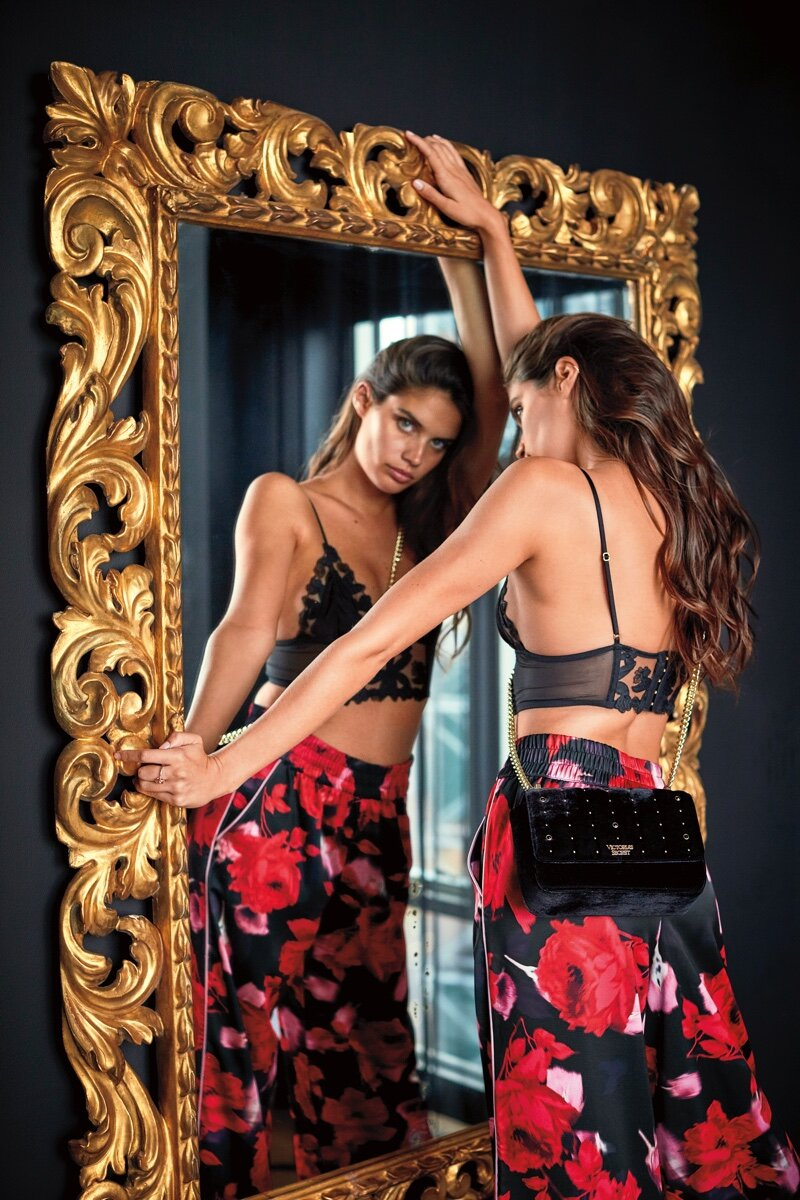 Sara Sampaio smells the roses in Victoria's Secret 2019 Holiday campaign.