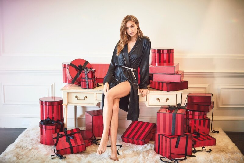 An overwhelmed Josephine Skriver counts so many holiday boxes to open Victoria's Secret Holiday 2019 campaign