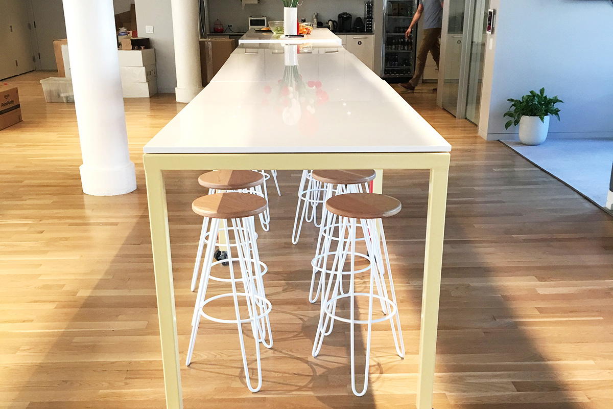 Updater New York Cord Industries hairpin leg bar stools in cherry with white legs.