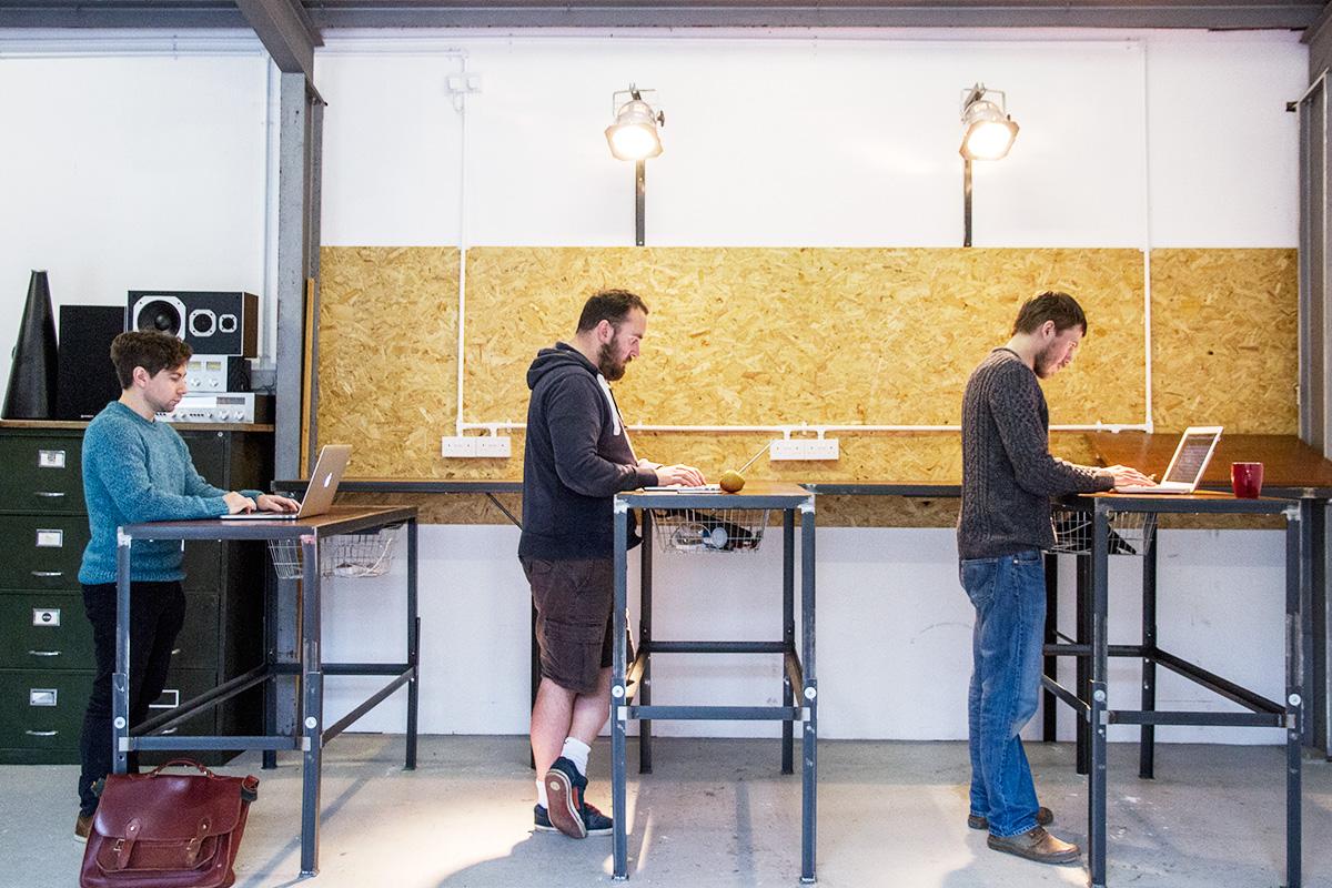 Set of Cord Industries adjustable-height standing desks at Hailer