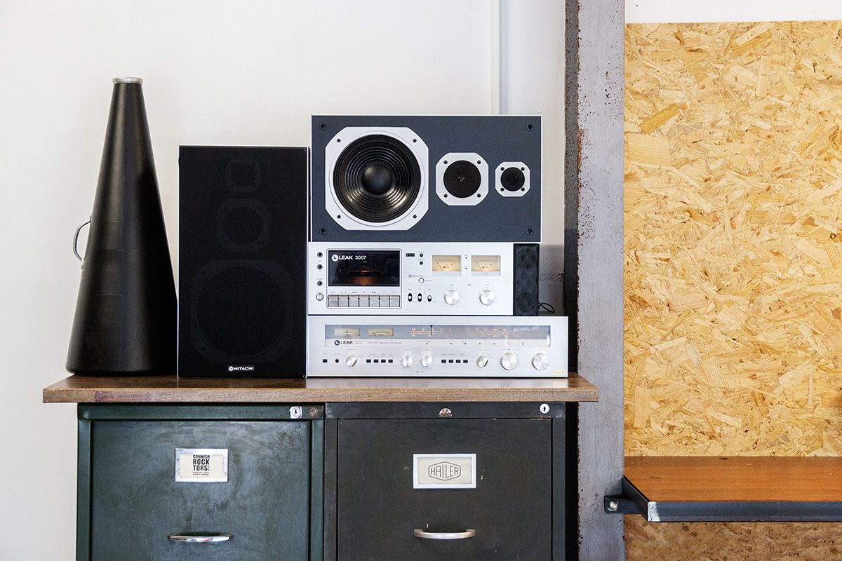 Vintage hi-fi at Hailer, on top of filing cabinet next to Cord Industries worktop.