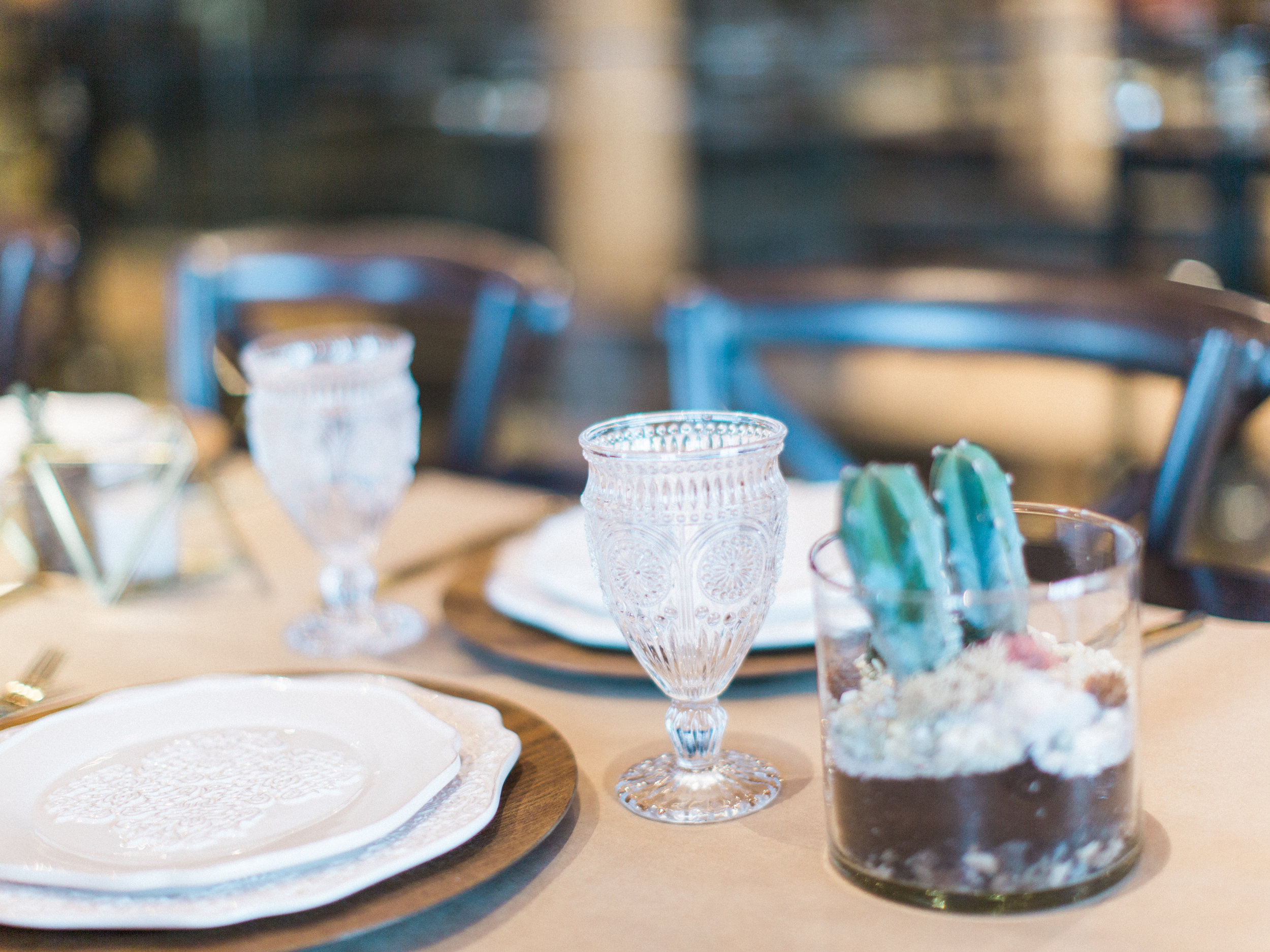 Get the look: wood charger plate, modern ornate dinner and salad plates, clear hobnail goblet