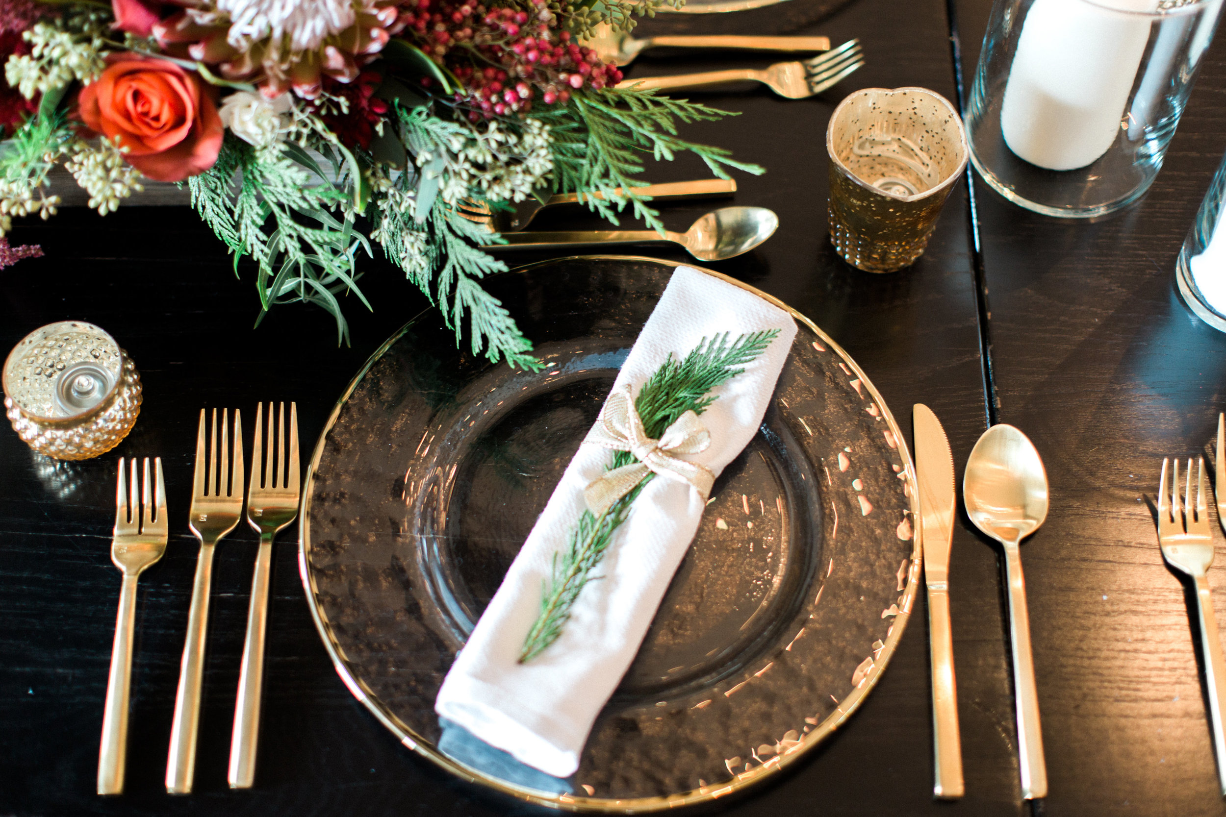 Get the look: matte gold cutlery, glass gold rim charger, glass candle holder, scalloped gold votive