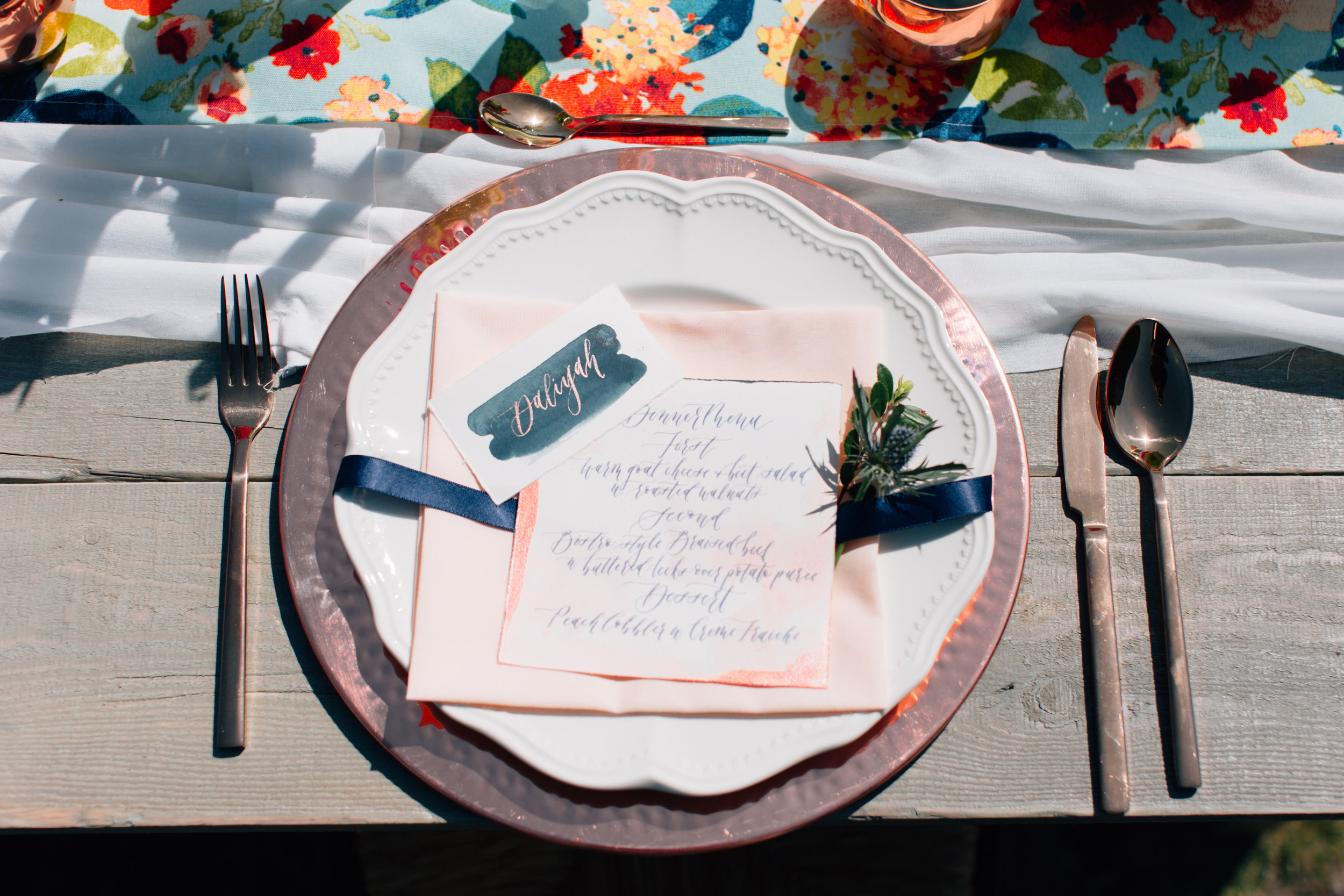Get the look: copper charger plate, rose gold cutlery, ivory dinner plate