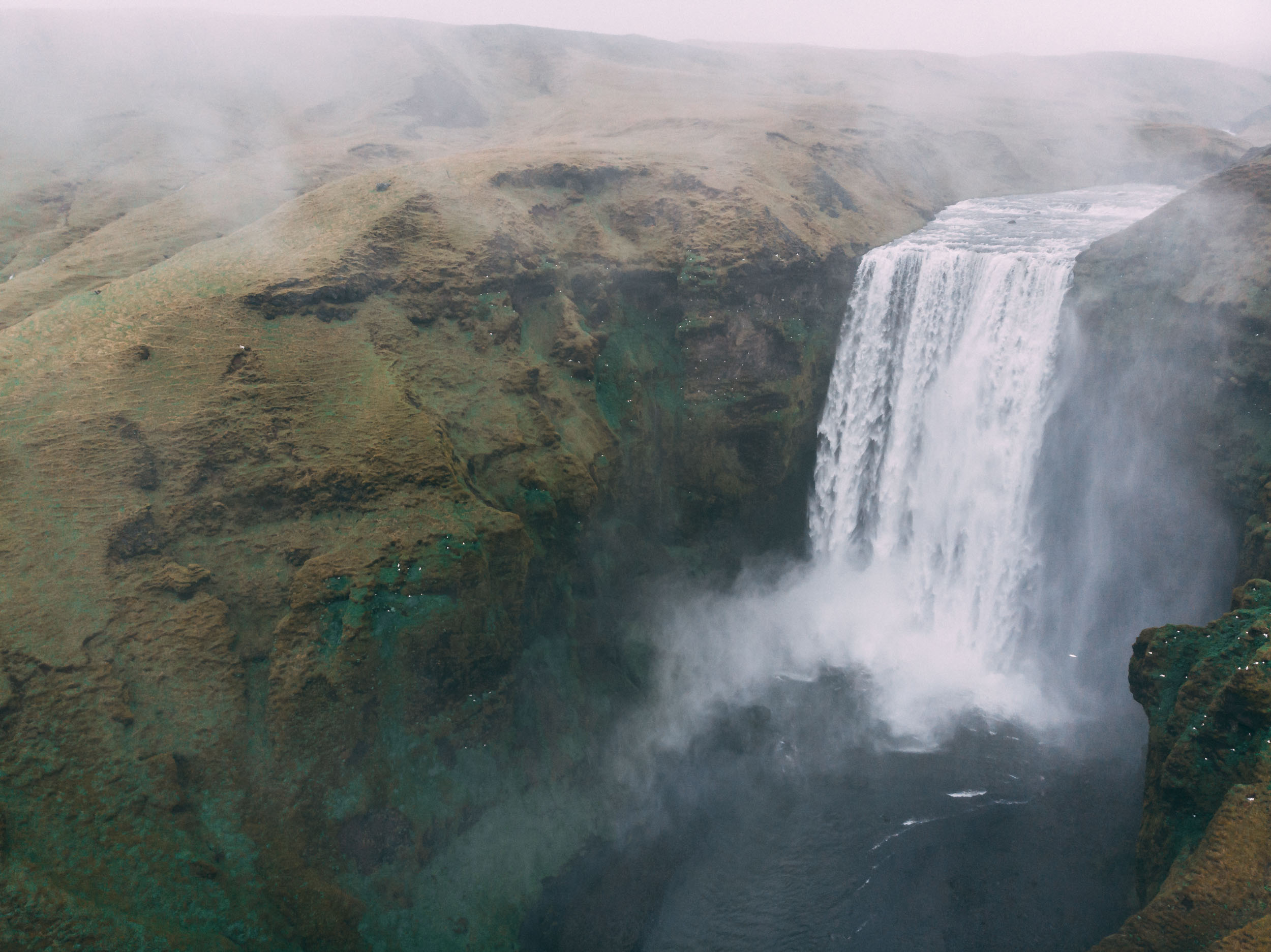 risk - Storm on its way and the rain is picking up, I launch my drone into the air amongst the mist of the waterfall, hoping it won't get plucked from the air by the rain and the wind as I rise above the waterfall.This photo taught me it takes risk to get the images we want.