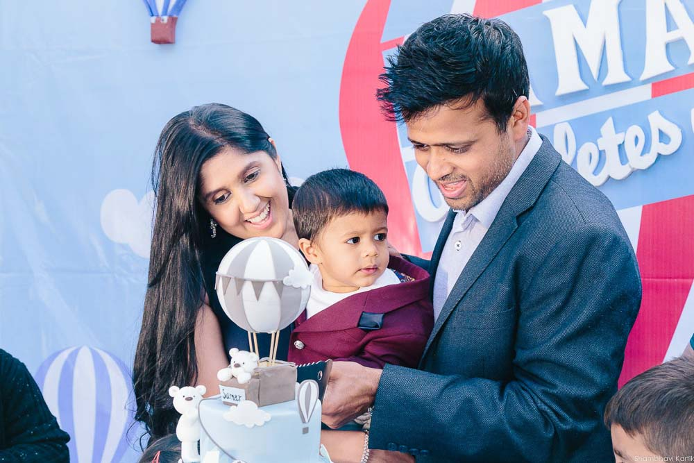 cake cutting of first birthday party photography delhi