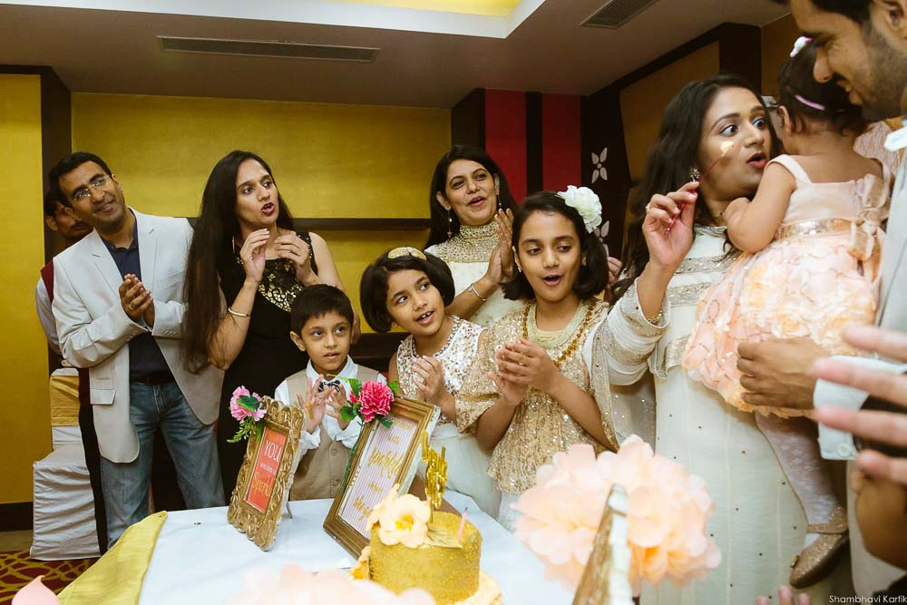 candid moments of cake cutting celebration