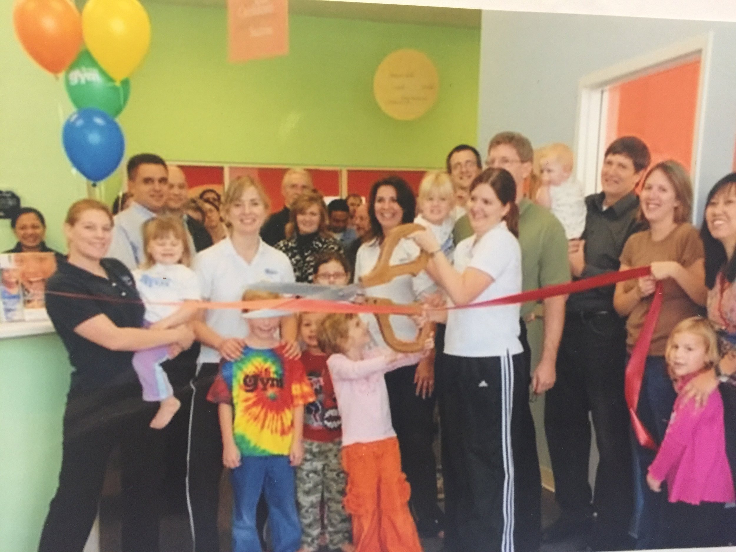 Ribbon Cutting in 2007. Notice the guy by the blue balloon. It's Corey! Then just family friend. Destined to be TLG Owner!