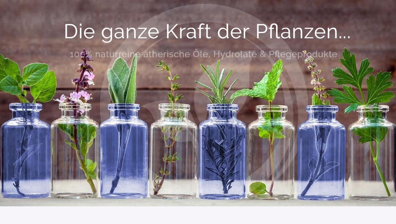 Oshadhi_bild mit Flacons und Pflanzen.JPG