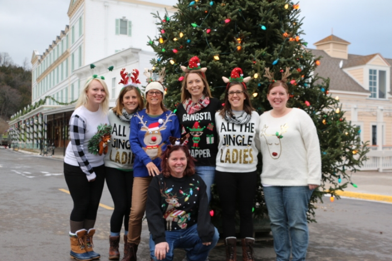 Our Joann's Fudge Christmas elves posing in front of the Main Street Christmas Tree