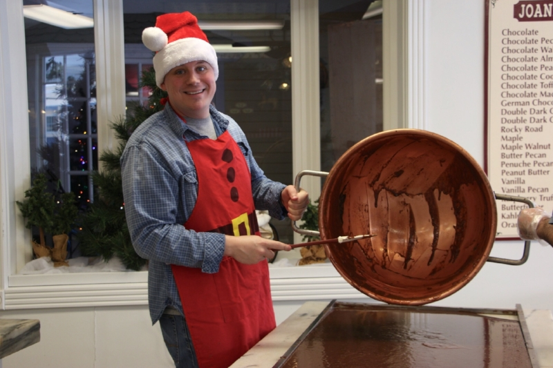 Pouring fudge from the copper kettle to the marble table.