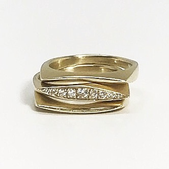 Oval sharp pave ring stacked either side with the skinny curve rings available in gold