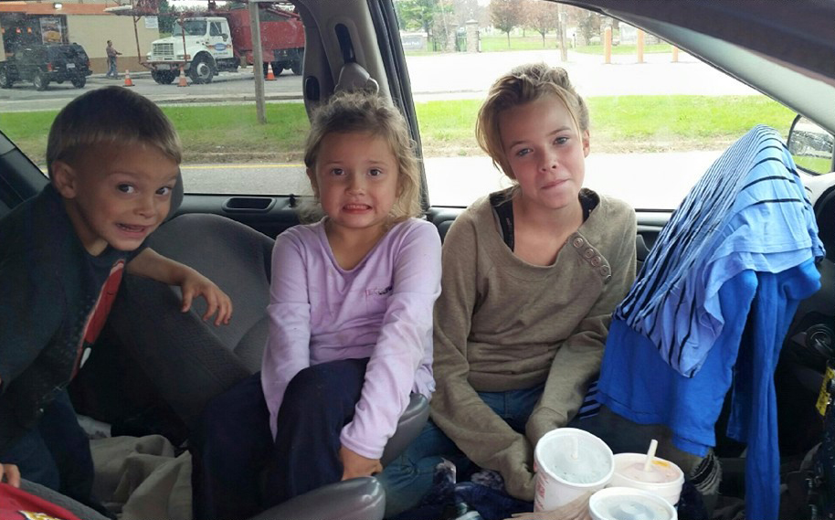 3 of the kids in the car where the family of 7 have lived for the past month