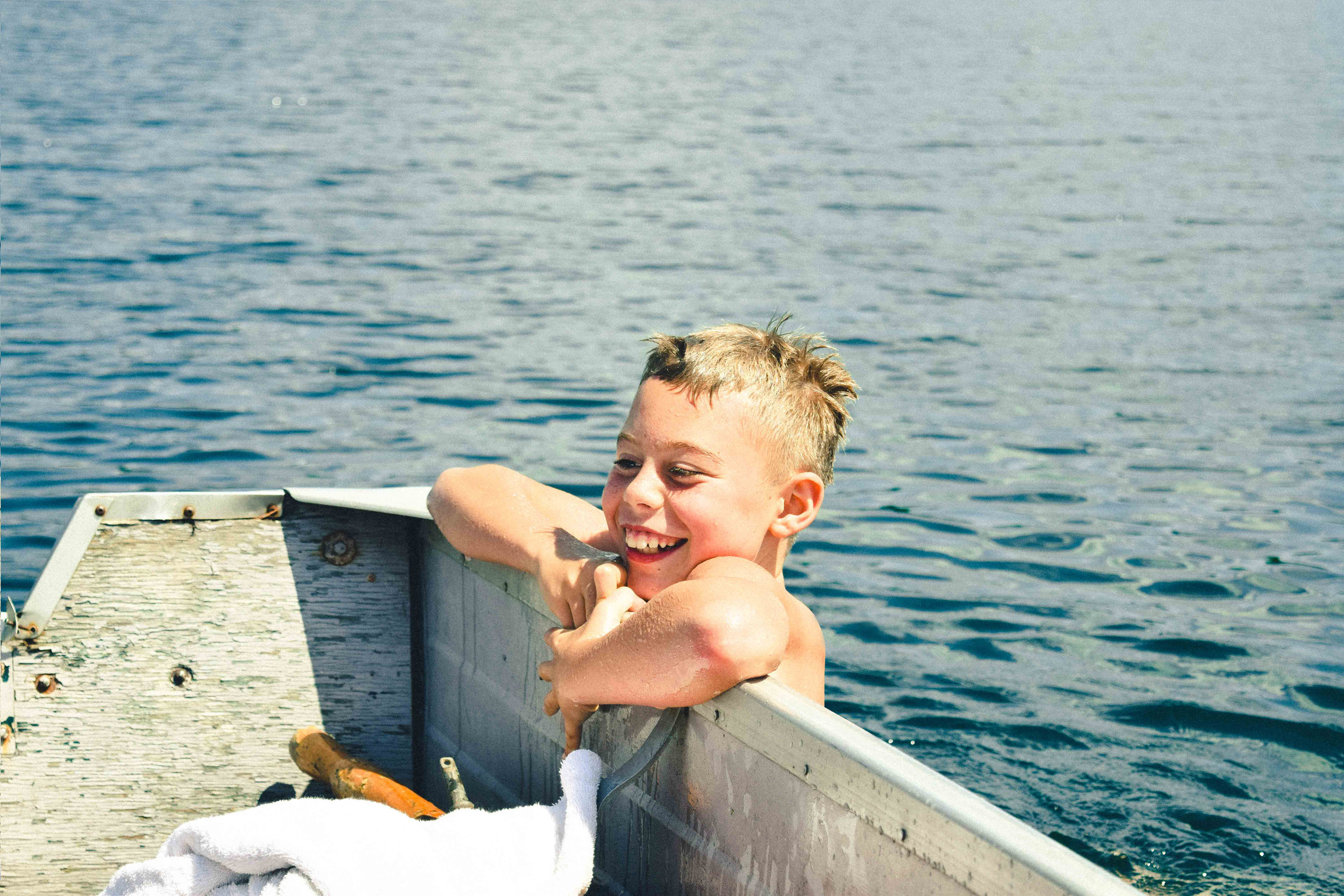 BOY ON BOAT--RTC-RYAN THOMPSON-PHOTOGRAPHY-TORONTO