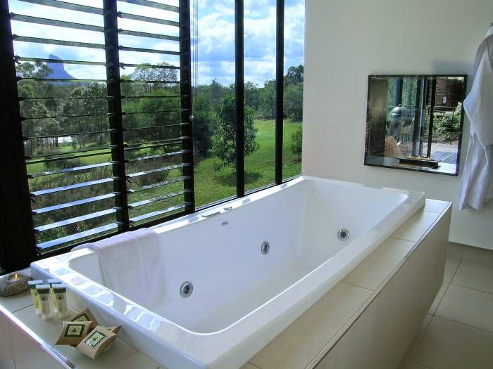 The amazing view from the bath at Glass on Glasshouse (the water falls from the roof! Amazing!)
