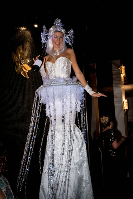 Life's little luxuries - champagne poured by a stilt walker!