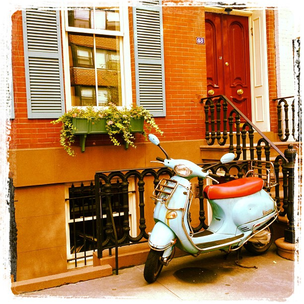 The Vespa matches the shutters.  (Taken with  Instagram )