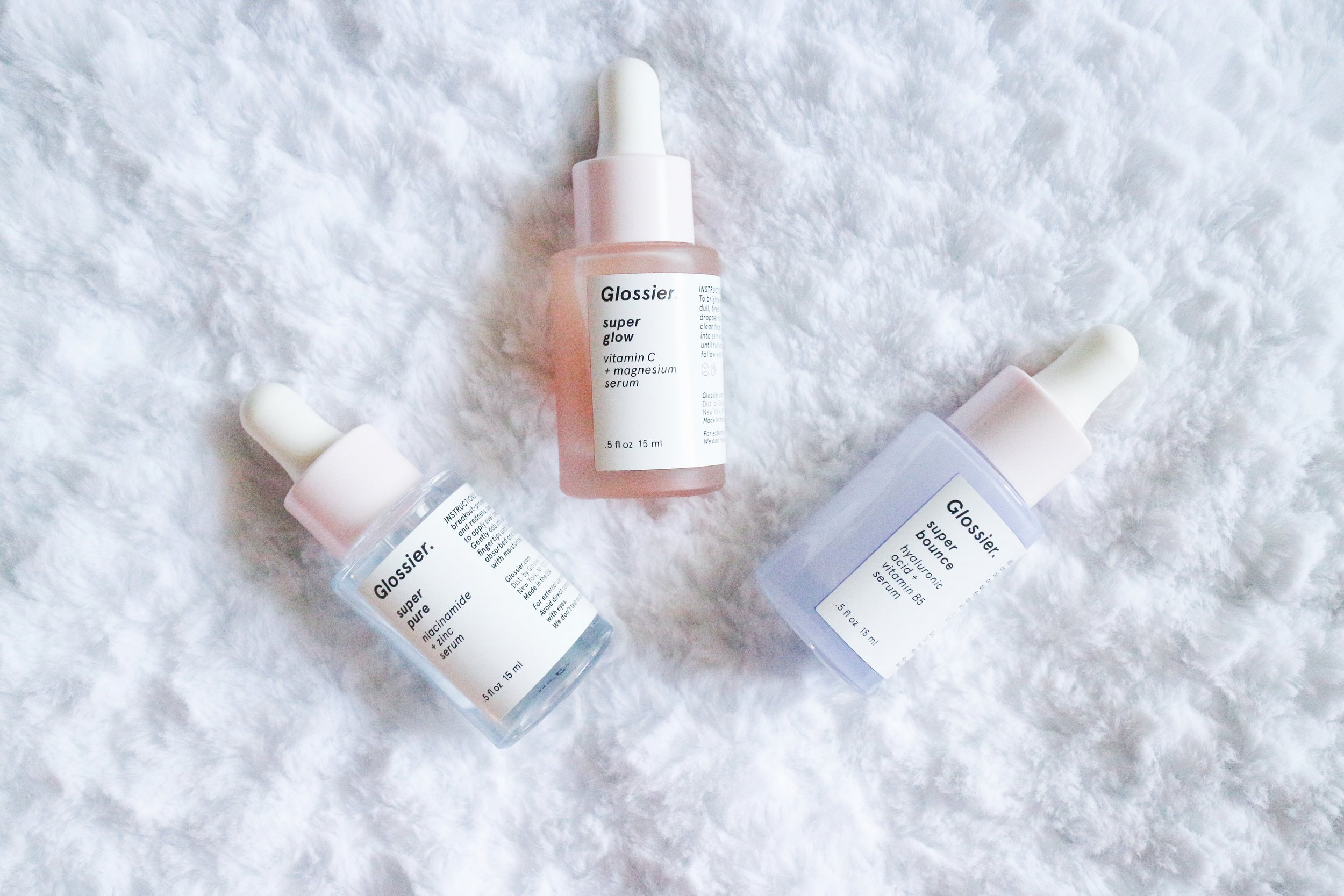 "The Glossier Super Serums are, ""super potent to help refill the skin's deficiencies and helps to strengthen it overtime"". There are three serums — Super Pure (middle), Super Glow (left), and Super Bounce (right). Buy all three for 465 or buy it individually for $28 each. More on the Glossier Super Serums on beautybyjessika.com."
