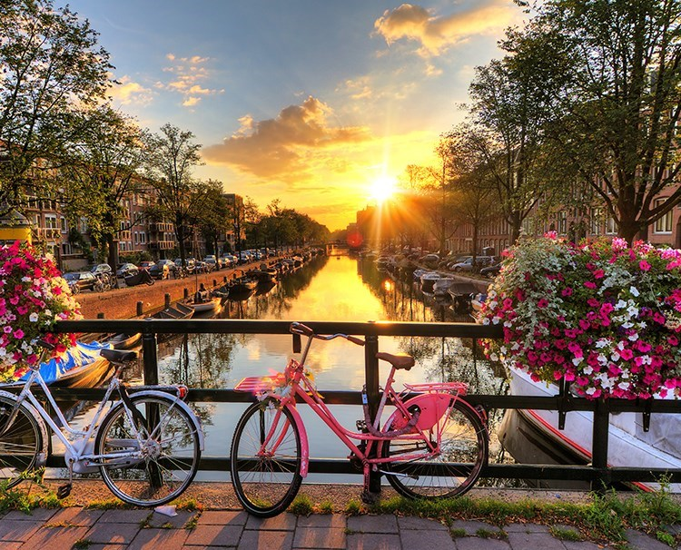 rhinemoselfairytales_NETHERLANDS_Amsterdam_Canalsatsunrise_ss_189863267_dailyprogram.jpg