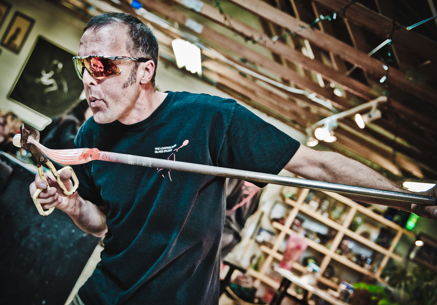 Shaping molten glass, the Loafing Shed Glass Studio