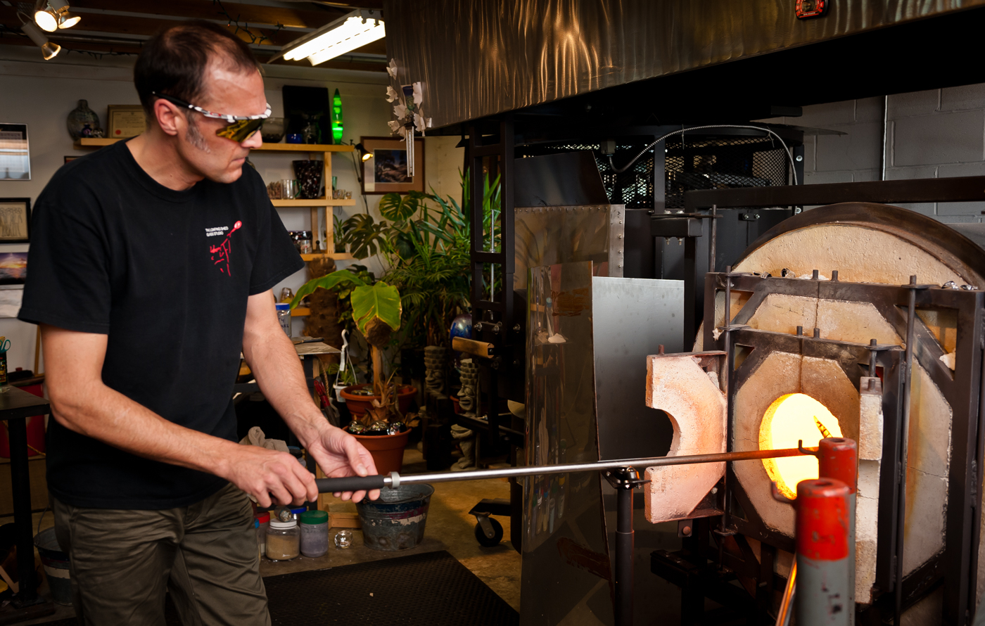 Apprentice glass blower at the Loafing Shed Glass Studio