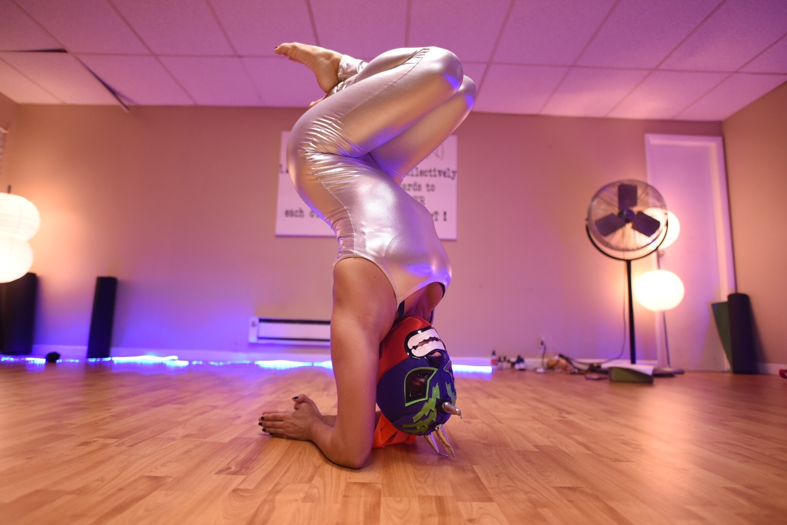 Call the yoga police! I dared to invert in a mask and silver unitard!