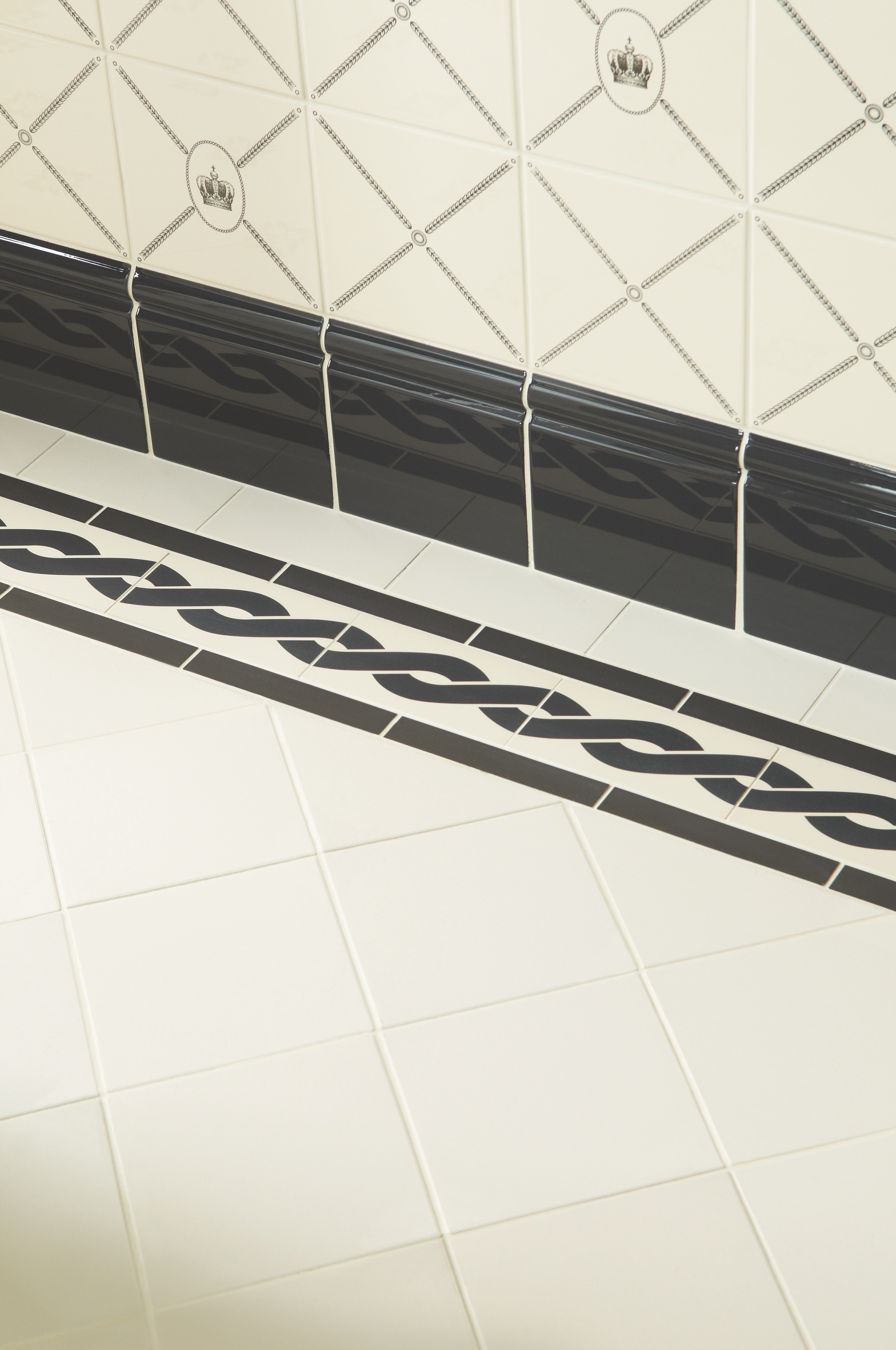 Original Style - VFT - Plymouth border Black on White with White floor tiles and Artworks tiles on wall.jpg