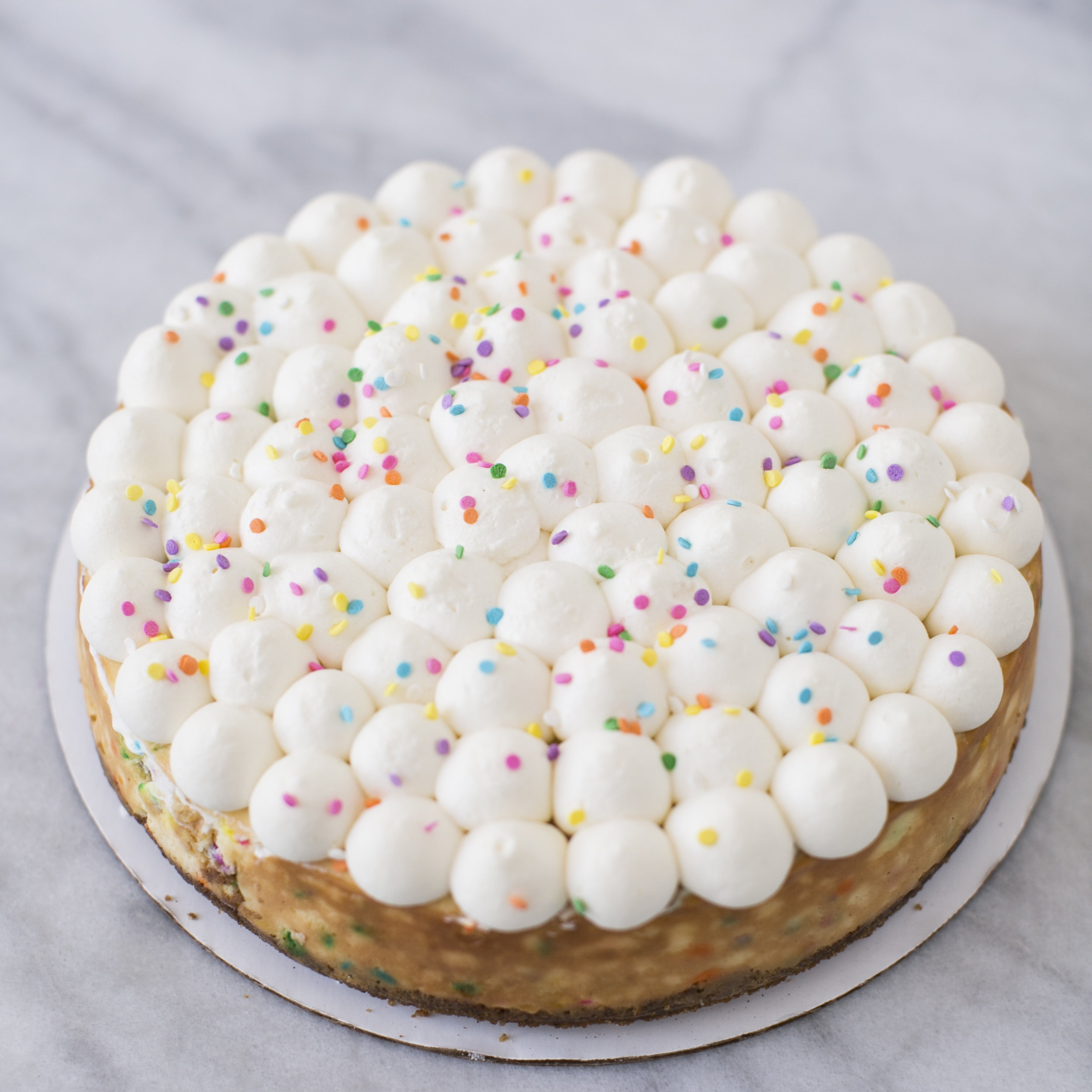 Confetti Cheesecake  Bright and Colorful sprinkles baked in!